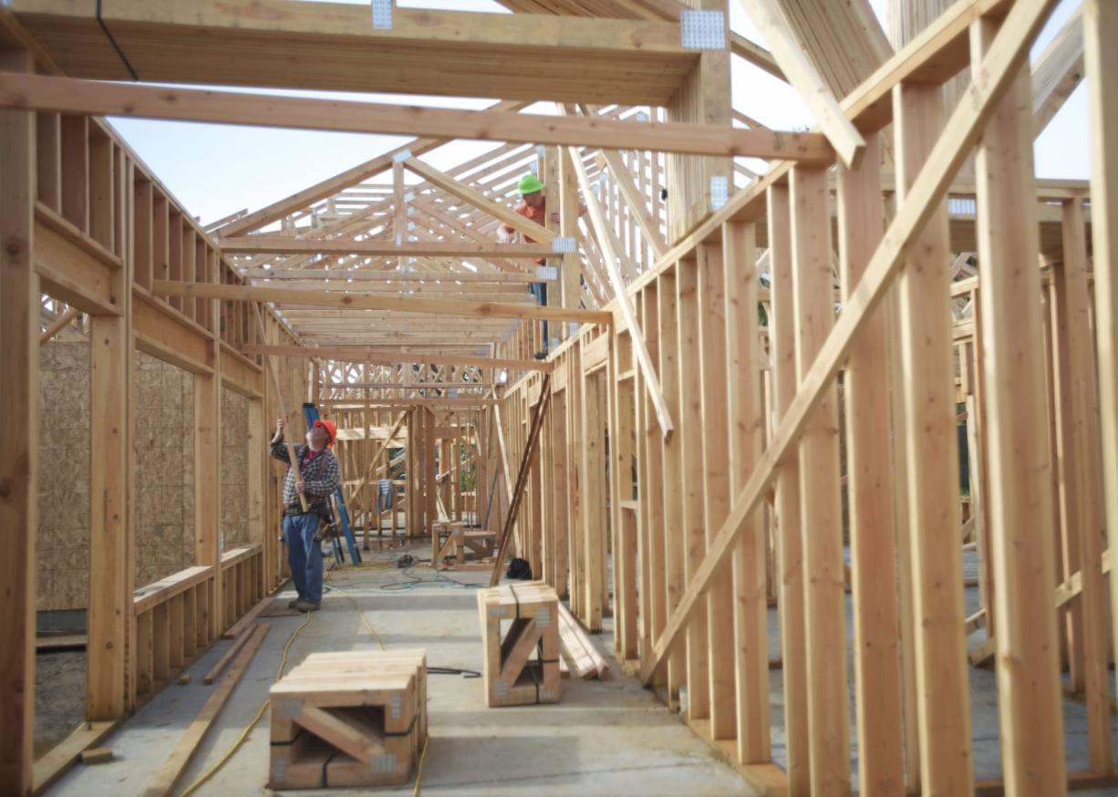 Workers recently positioned trusses on The Hampton at Salmon Creek, a 43-unit care center for seniors with memory issues.