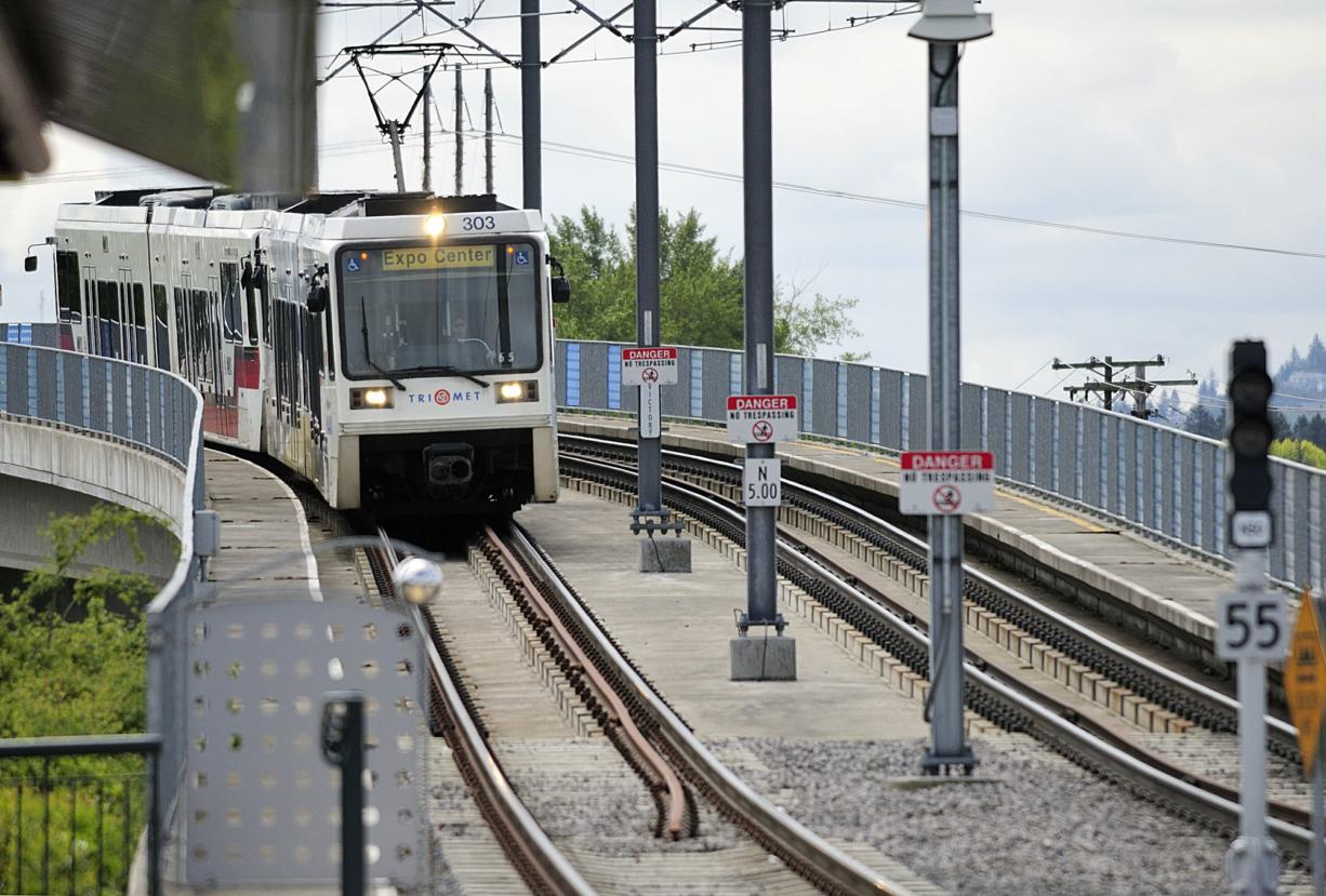A light rail train makes its way to the Delta Park/Vanport transit station.