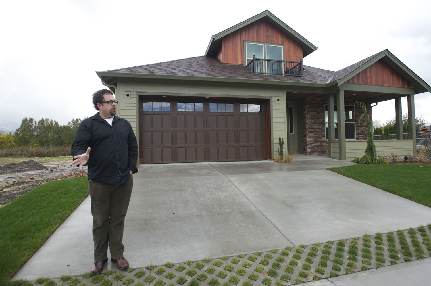 "Urban NW Homes founder and owner Troy Johns stands outside a Salmon Creek-area house that aims to be the area's first ""net zero"" home. The structure is designed to produce more energy than it consumes over time, and will have Emerald designation under the National Green Building Standard."