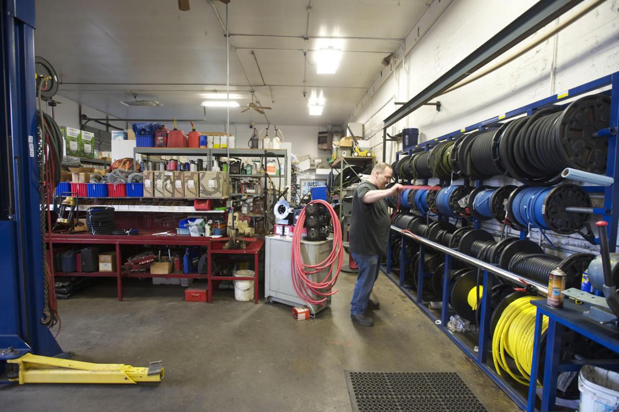 Jason Turner sorts supplies at Northwest Tubes N' Hoses.