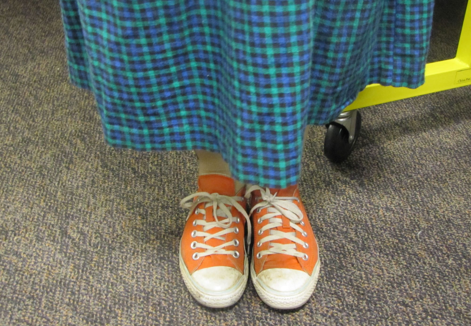 Eleven-year-old Benedicta Hardy tries on her re-enactor's dress while wearing her everyday shoes.