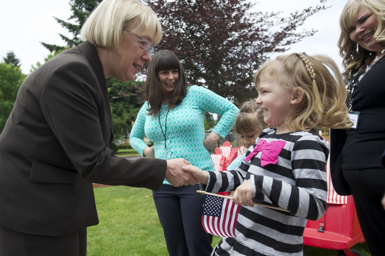 Laney Fant, 5, a student at the Patricia Nierenberg Child Care and Early Learning Center, welcomes U.S. Sen. Patty Murray, D-Wash., to the center on Friday.