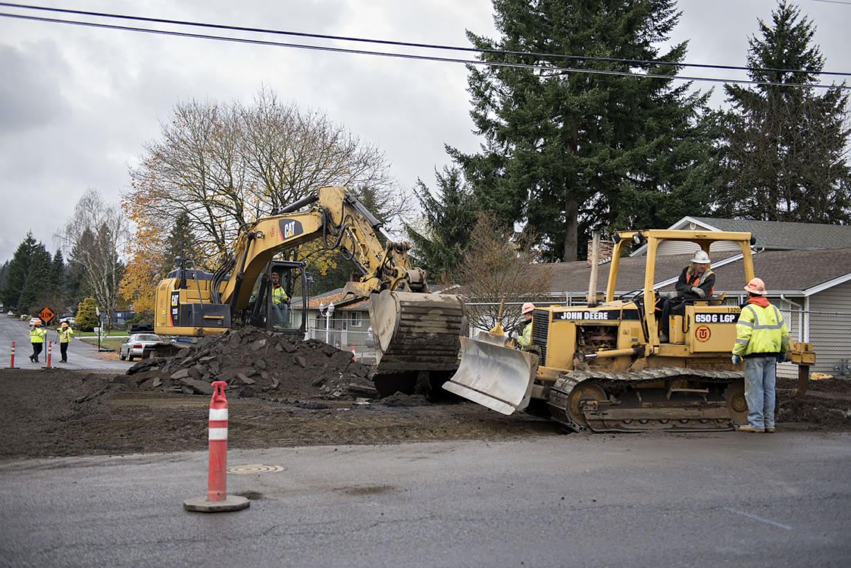 Construction crews work near the intersection of Northeast 94th Avenue and Northeast 96th Street on Nov. 24, 2015.