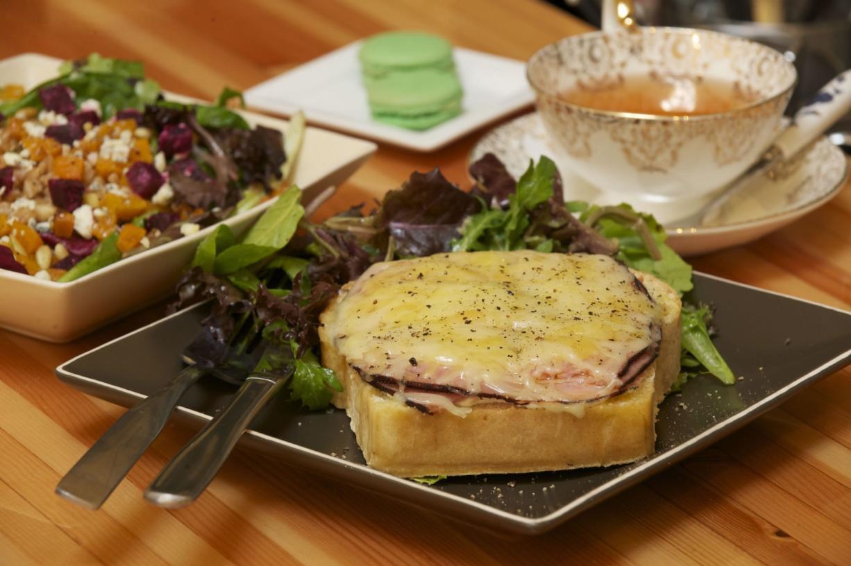 A Croque Monsieur sandwich with beet, butternut squash, gorgonzola and pine nut salad, tea and pistachio macaron is served at C'est la vie.