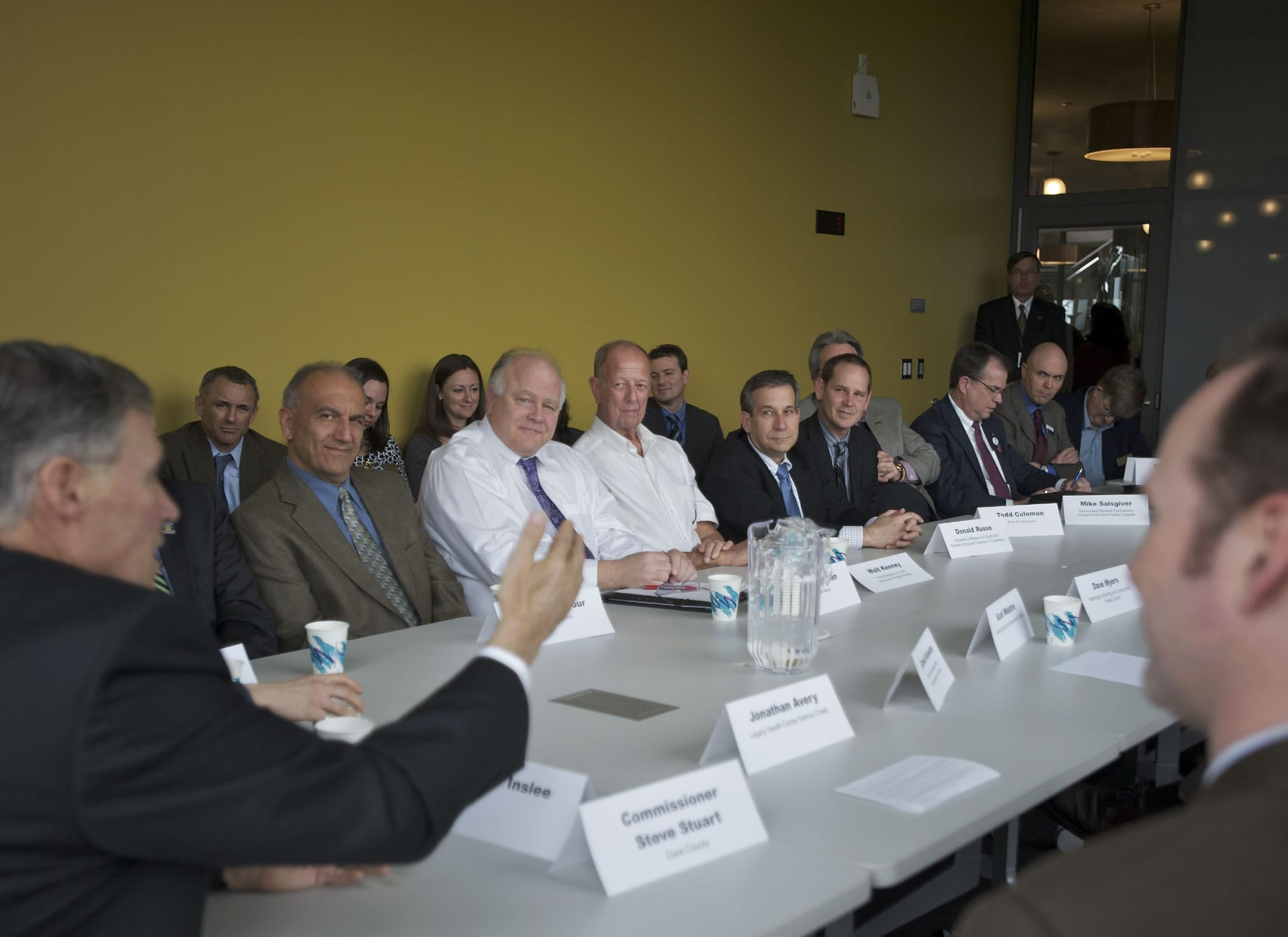 Gov. Jay Inslee meets with business leaders at the Vancouver Community Library on Friday.