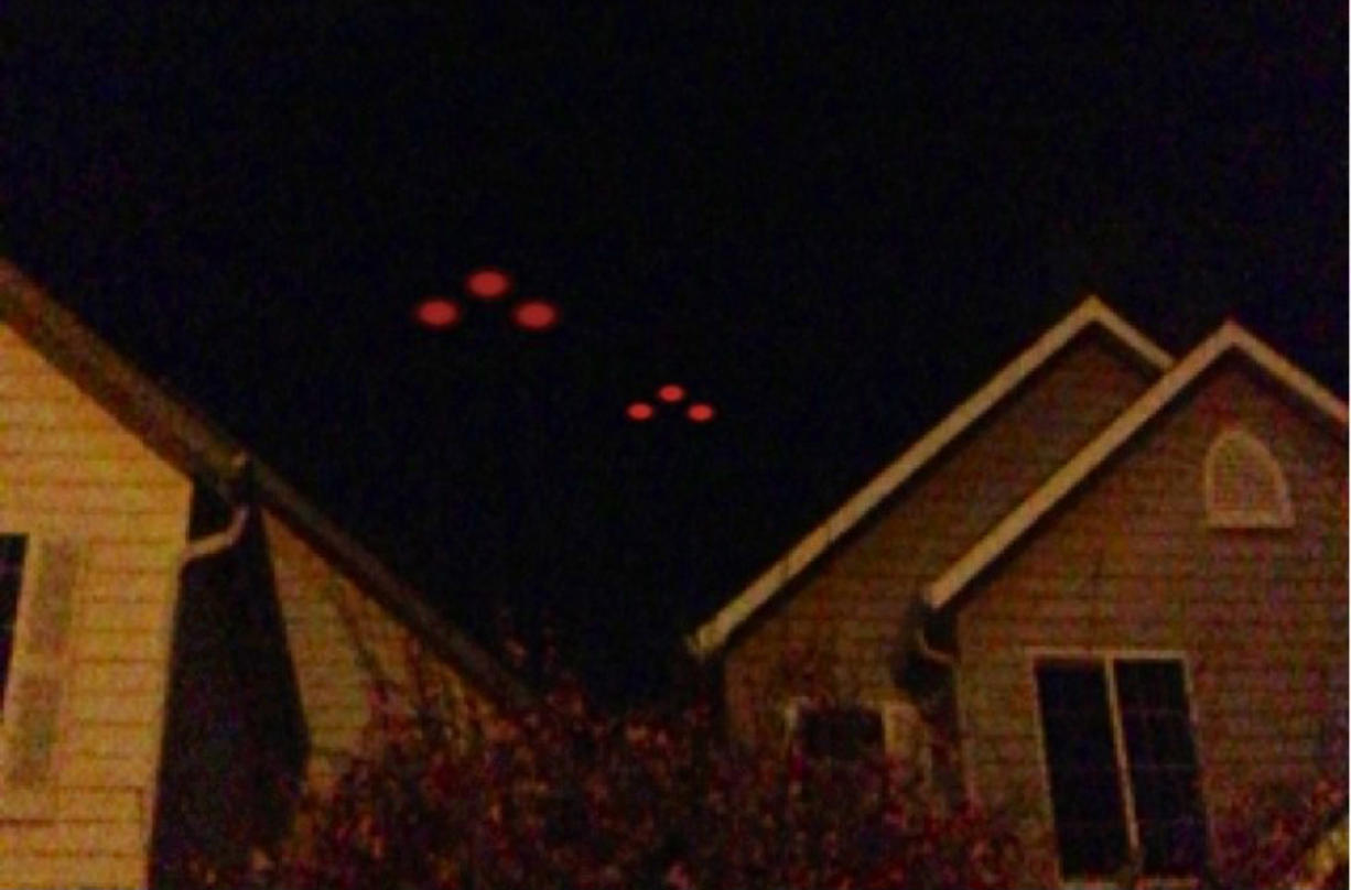 The husband of Battle Ground resident Nicole Keller captured this image of strange lights in the sky with his cellphone Monday. He didn't want his name used in the paper, she said. Her husband took the picture close to midnight, and the lights moved south in the sky for about five minutes, she said.
