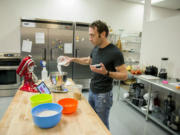Matthew Barbee, head of recipe development for Perfect Co., makes chocolate chip cookies using Perfect Bake at the company's downtown Vancouver test kitchen.