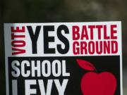 "A sign advocating for a ""yes"" vote on an upcoming Battle Ground school levy in front of a home on Northeast 117th Avenue near Prairie High School."