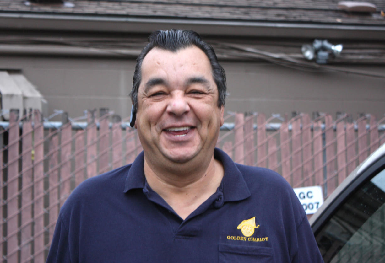 Vancouver Heights: Ron Trujillo beams after being named the 2013 Paratransit and Contracting Driver of the Year.