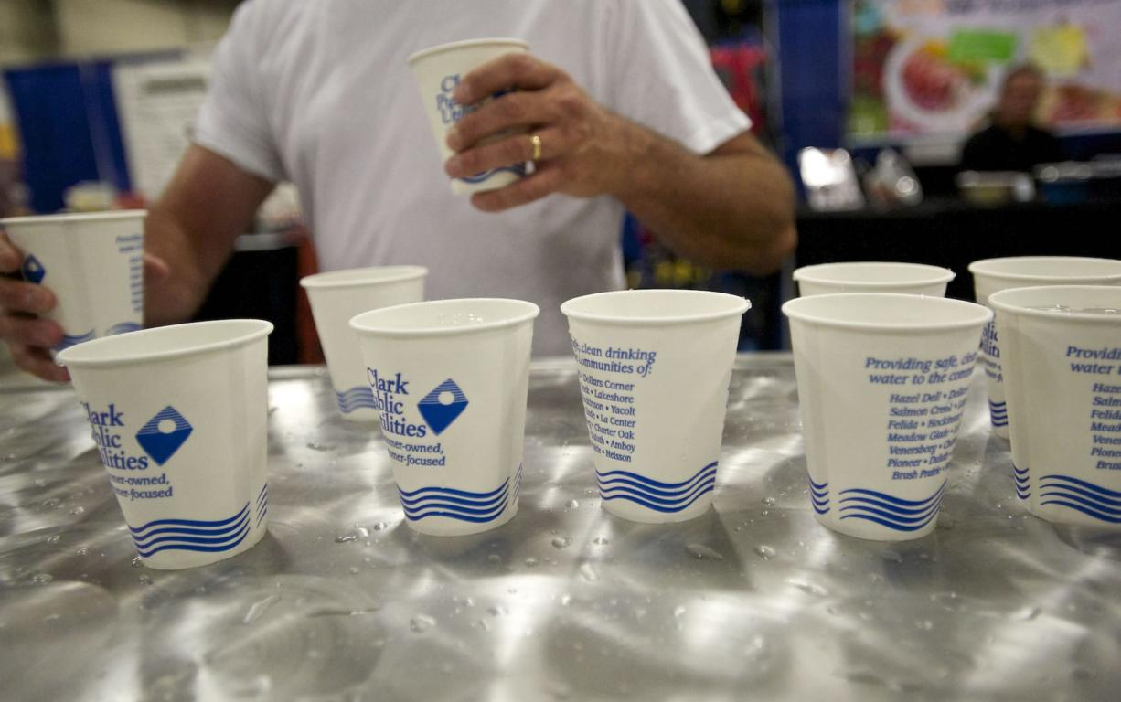 A fairgoer grabs ice water courtesy of Clark Public Utilities at the Clark County Fair on Monday.