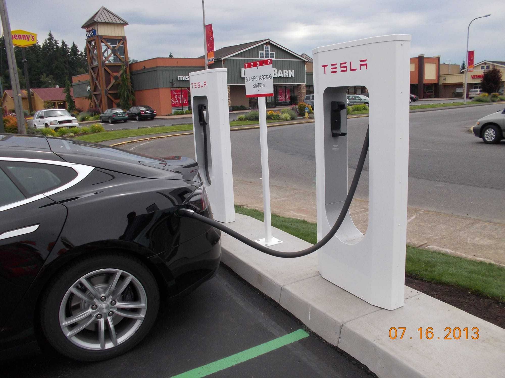electric car gives a charge to local firm columbian com electric car gives a charge to local
