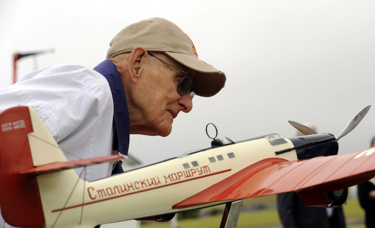 Evan Petcoff, who was at Pearson Field on the day of the Chkalov landing in 1937, examines the ANT-25 model on display just prior to Wednesday's 75th anniversary observance.
