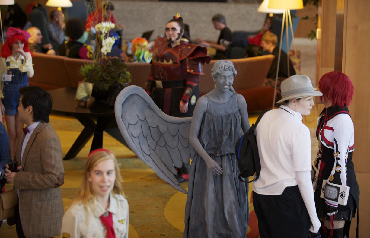 "Hilary Beutler, 21, of Clackamas, Ore., dressed as the Weeping Angel from the British TV show, ""Dr. Who,"" as part of the anime convention, Kumoricon 2012, which took place Saturday in downtown Vancouver."