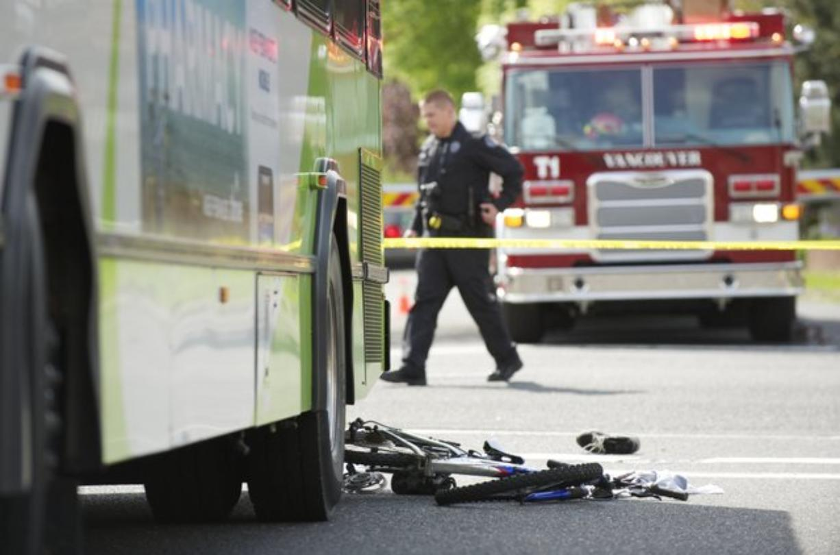 Police investigate an April 28, 2012 accident where a C-Tran bus collided with boy on a bike at the intersection of 27th and Main in Vancouver.