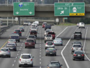 Traffic flows north on Interstate 5 during afternoon rush hour earlier this year.