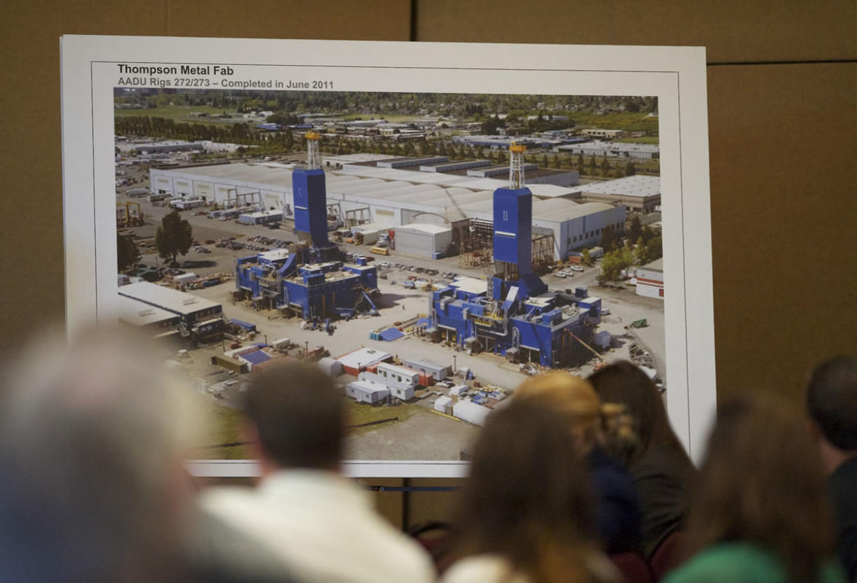 A photograph displayed  at Tuesday's CRC hearing shows oil rigs built by Thompson Metal Fab, which their executives say will be too large to cross underneath the proposed new bridge.