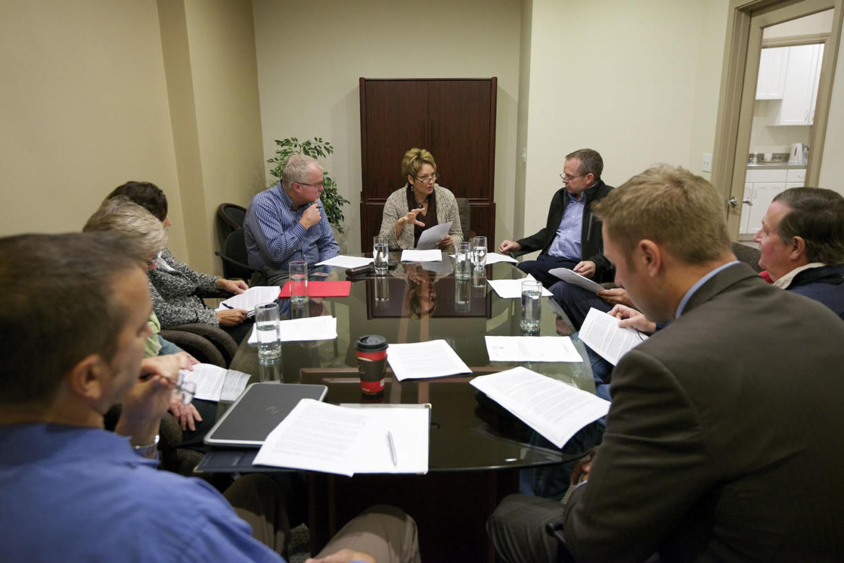 State Rep. Liz Pike, R-Camas, talks about government regulation on Wednesday with eight business leaders from Clark County. The group met at her district office in downtown Camas.