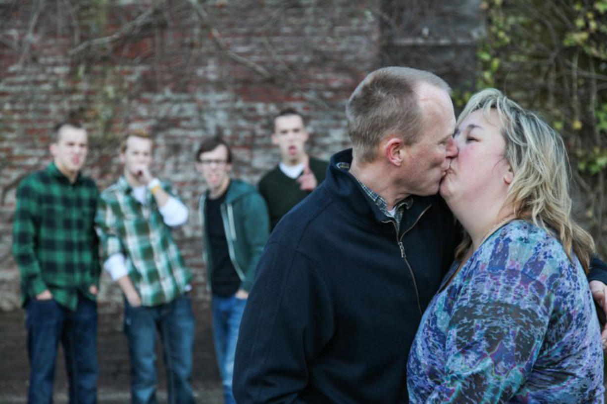 Provided photo   Steve and Susan Oberst of Battle Ground share a kiss in this family photo taken in the spring of 2011. Steve Oberst was diagnosed with prostate cancer in February. The couple has four sons, in background, from left, Taryn, Connar, Skyler and Nolan.