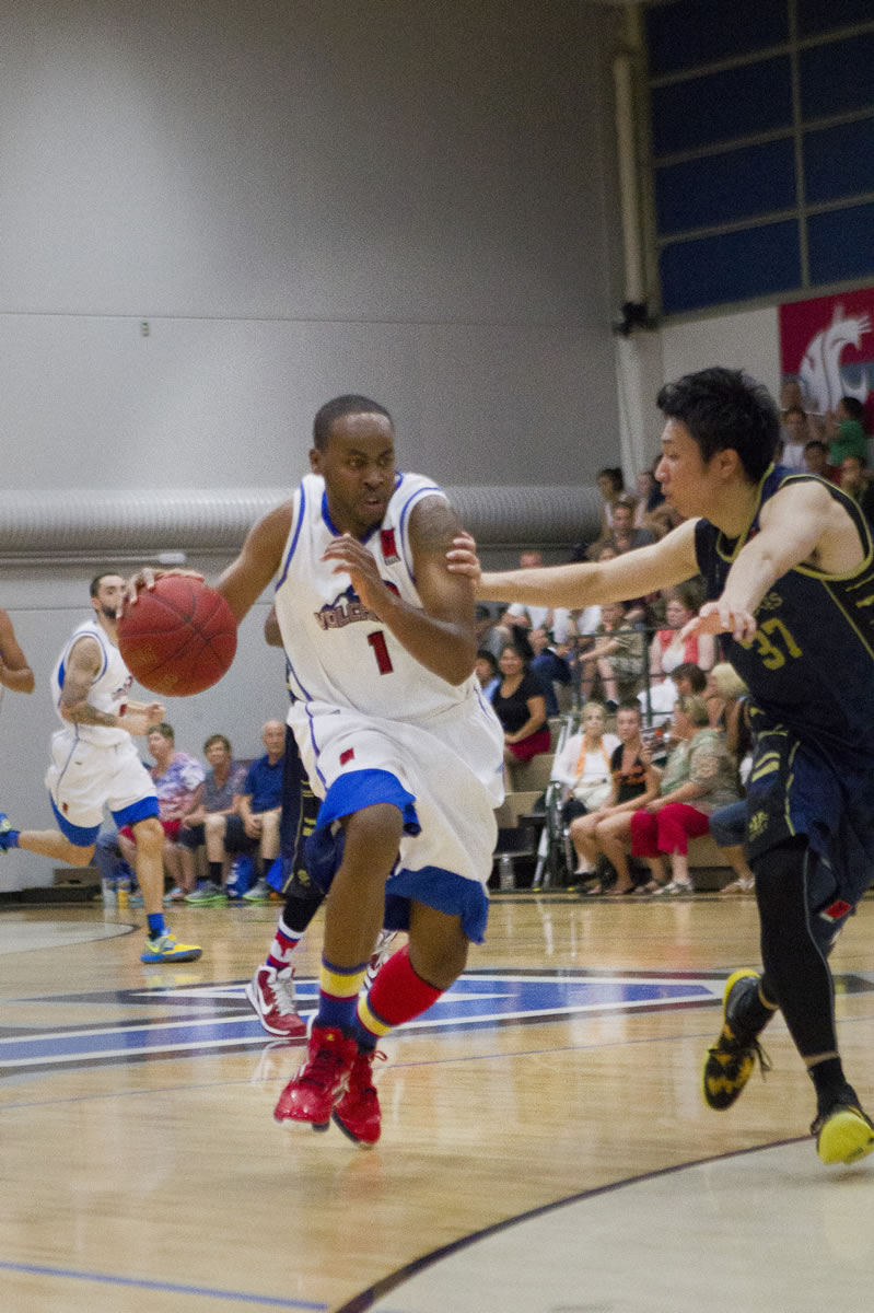 Vancouver Volcanoes' Mike Ward drives against the Japan Nippon Tornadoes in the regular-season finale Sunday at the O'Connell Center.