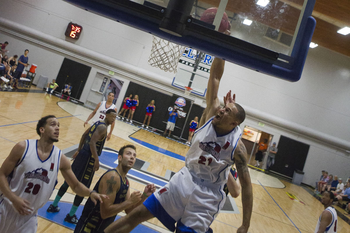 Vancouver's Kevan West (21) scored 13 points in the Volcanoes' win.