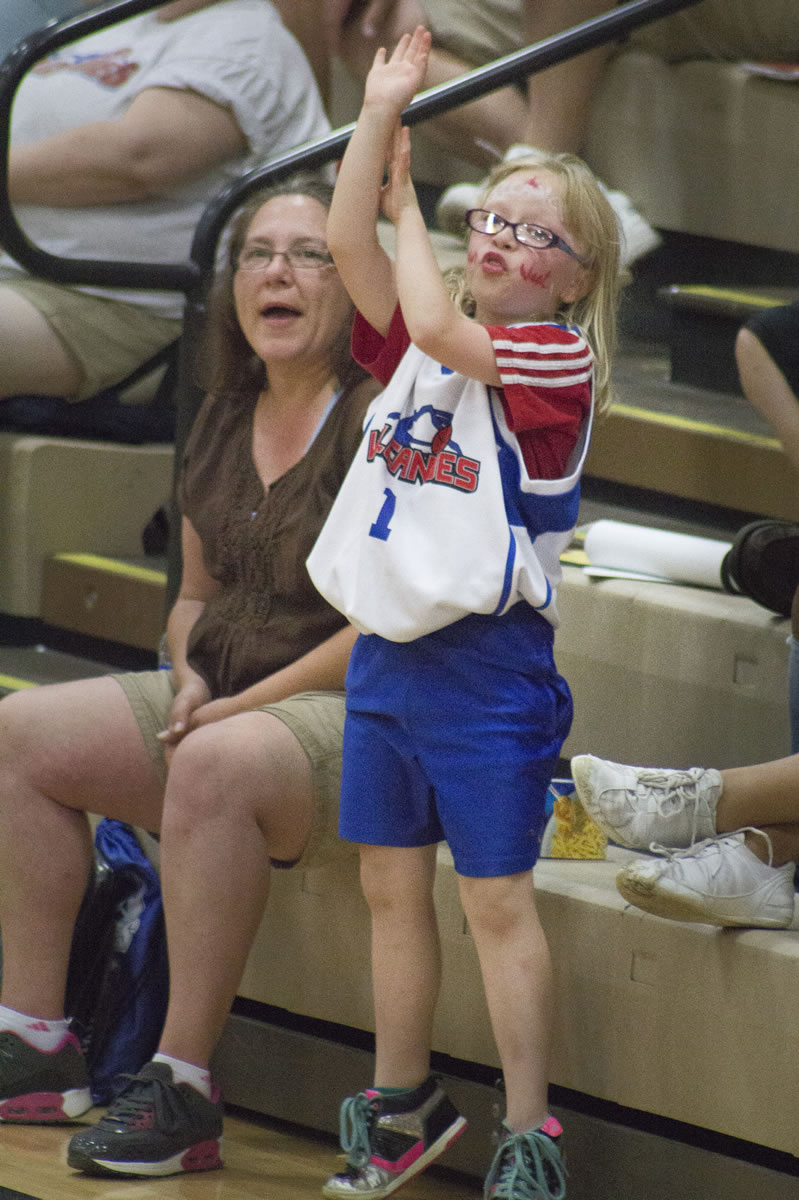 Madi Sibert, 8, gets into Fan Appreciation Night with the Vancouver Volcanoes by helping out during a free throw at the Volcanoes last home game of their season on Sunday, where they beat the Japan Nippon Tornadoes.