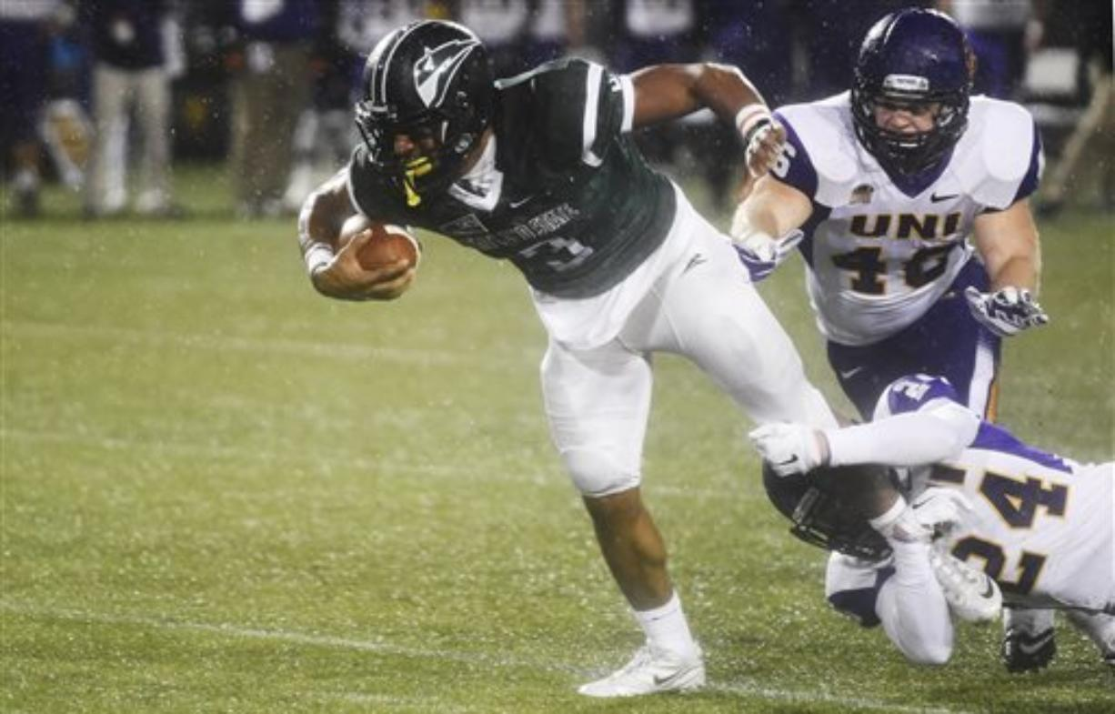Portland State running back David Jones (3) is brought down by Northern Iowa defensive back Tim Kilfoy (24) and linebacker Jared Farley (46) during the first half of a second-round NCAA FCS playoff game at Providence Park on Saturday, Dec. 5, 2015, in Portland, Ore.