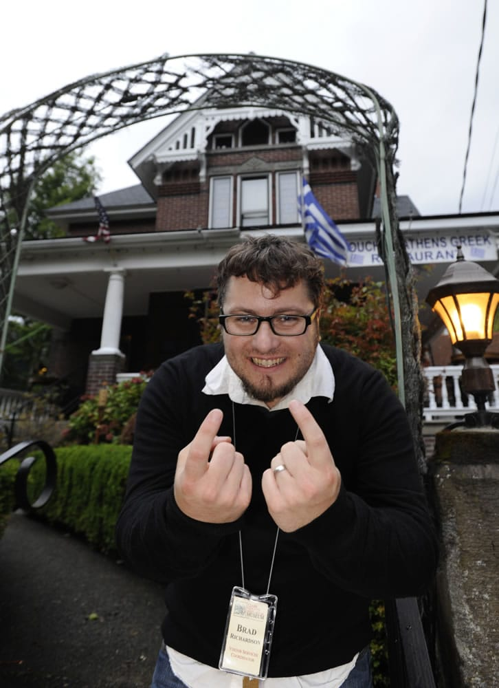Brad Richardson of the Clark County Historical Museum welcomes visitors to Hidden House, now a Greek restaurant, where some have reported hearing mysterious singing, doors locking by themselves and other strange occurrences.