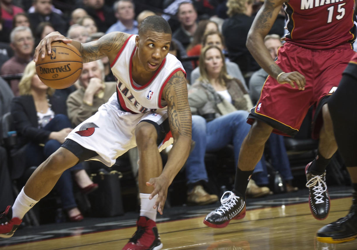 Portland's Damian Lillard commands the court as the Trail Blazers take on the Heat in the first half at the Rose Garden.