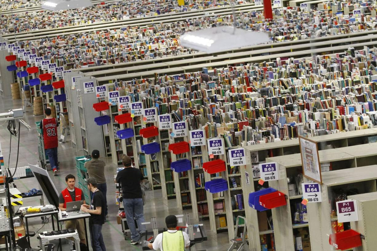 Workers push carts of merchandise at the Amazon.com Phoenix Fulfillment Center in 2010.