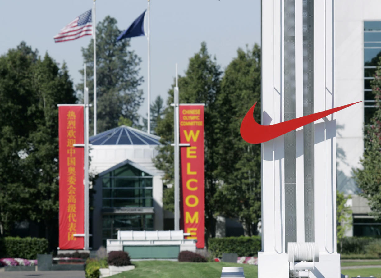 The red Nike swoosh marks the entrance to the company's headquarters campus in Beaverton, Ore.
