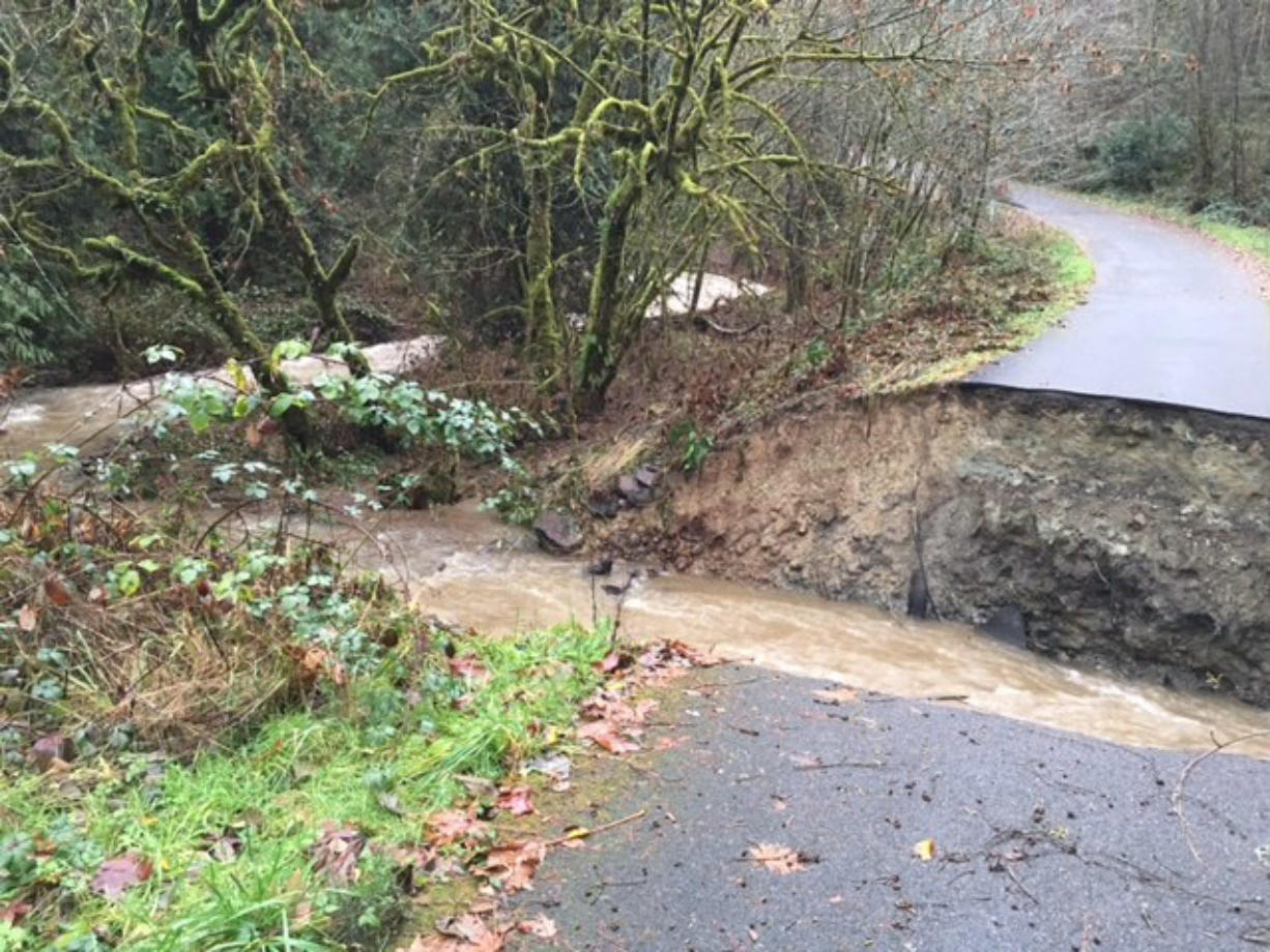 Water from this week's heavy rains washed out a private road serving six families in La Center.