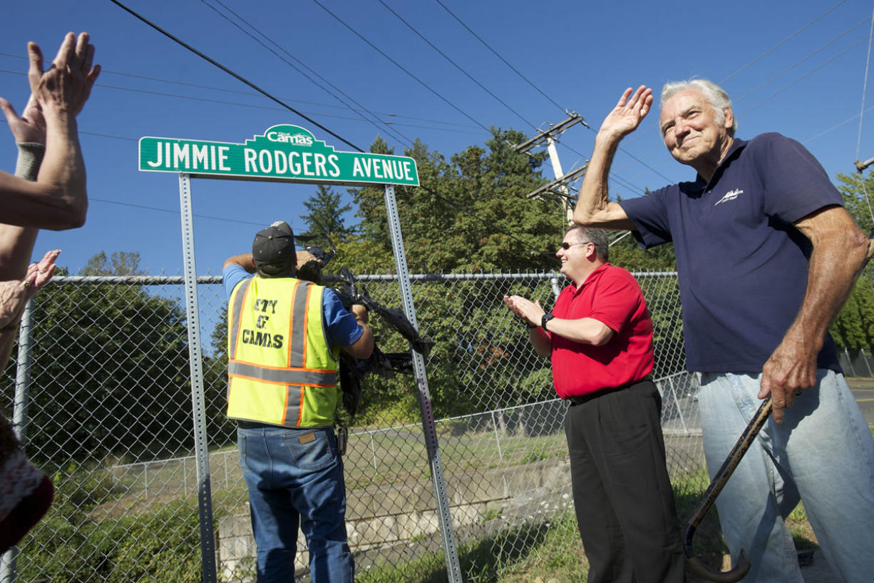Pop singer and Camas native Jimmie Rodgers waves to the crowd during a street sign dedication ceremony Friday.