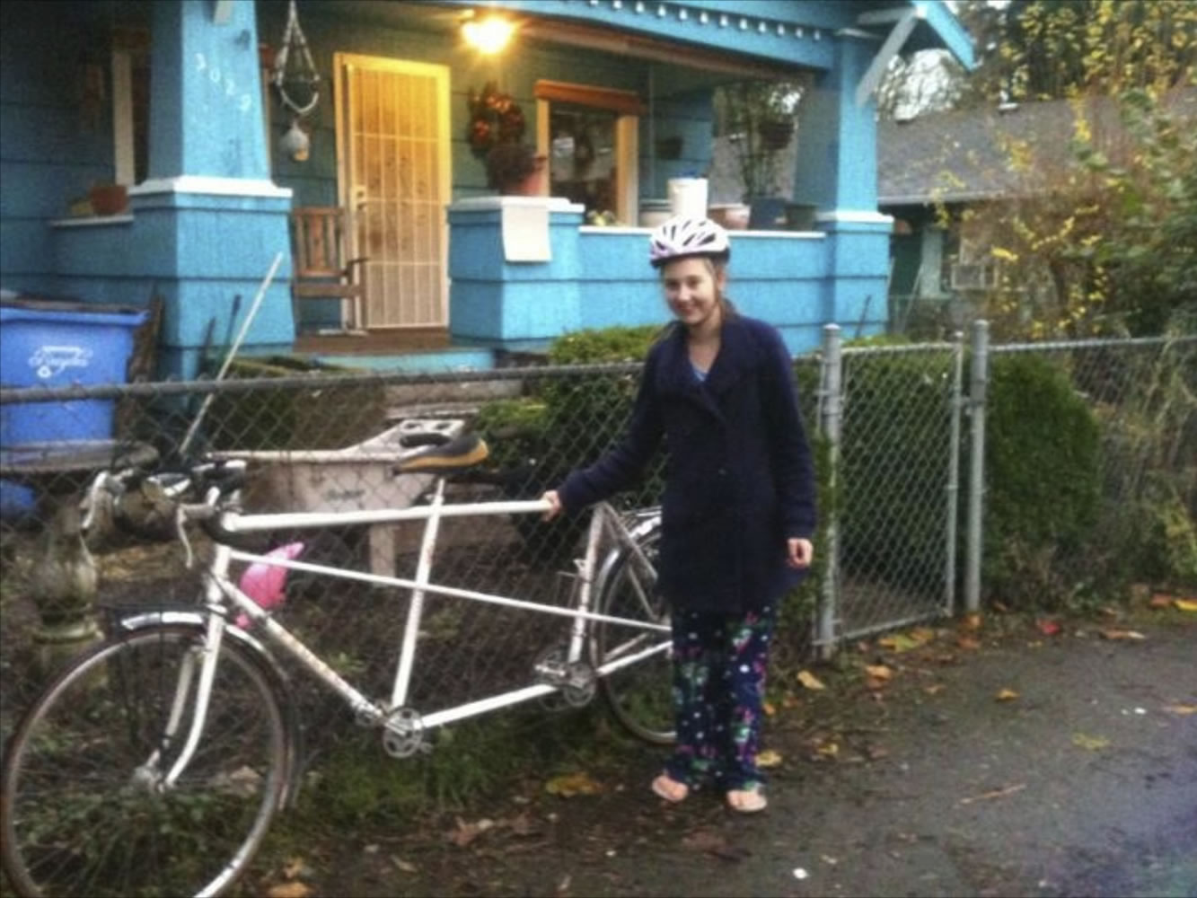 Courtney Forbes stands next to her tandem bicycle.