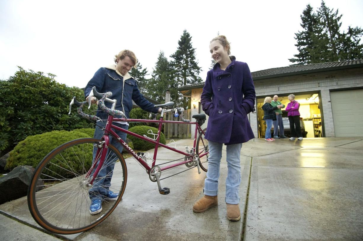 Harly and Courtney Forbes smile as they admire their new tandem bicycle given to them by Jackie and Richard Riordan on Tuesday in Vancouver. The Riordan's gave the bike to Harly and Courtney after their tandem bike was stolen the day before.