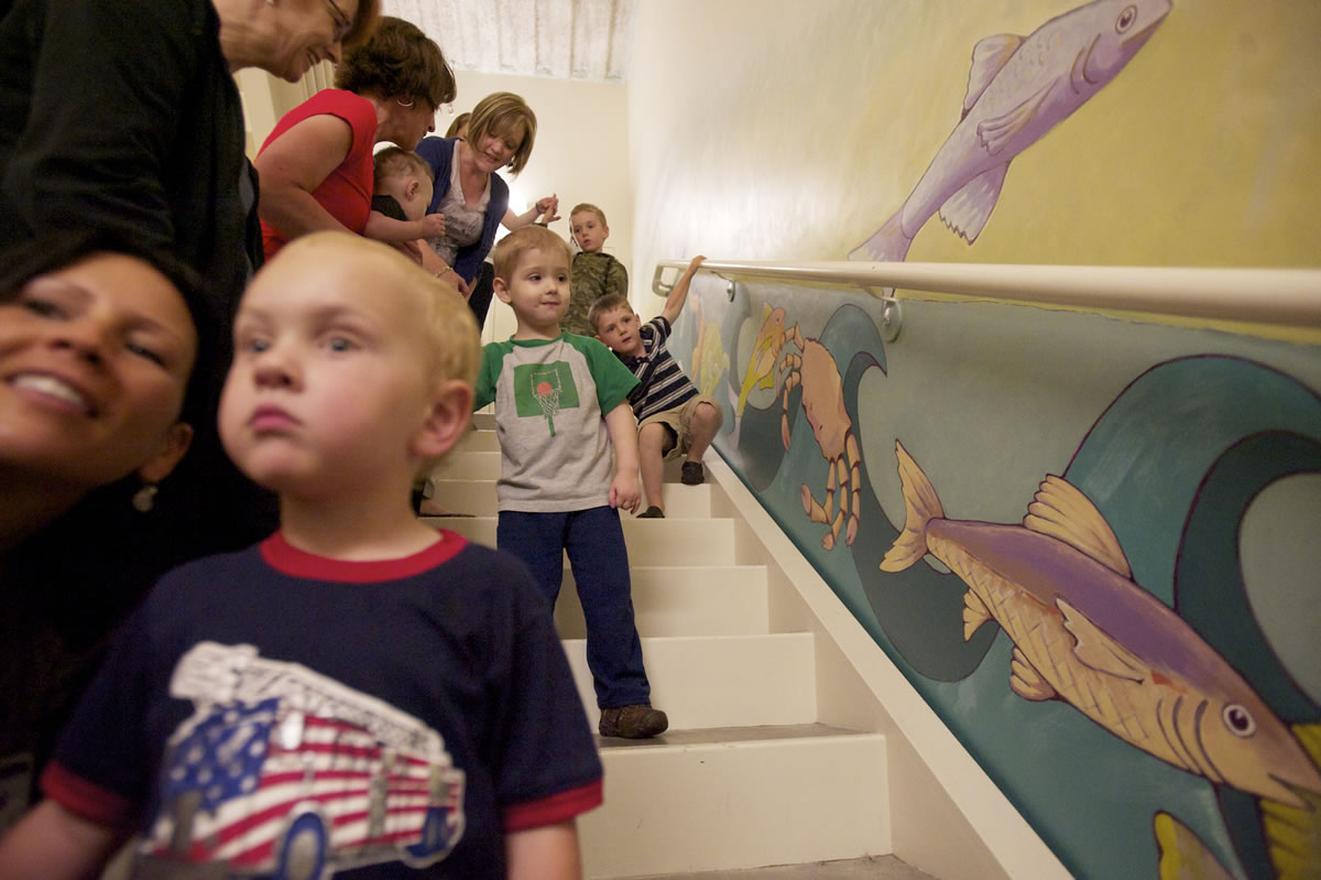 Photos by Steven Lane/The Columbian Roman Kushniryuk, 4, center, said the crab was his favorite among the animals painted on the side of the stairwell where he does some of his physical therapy.