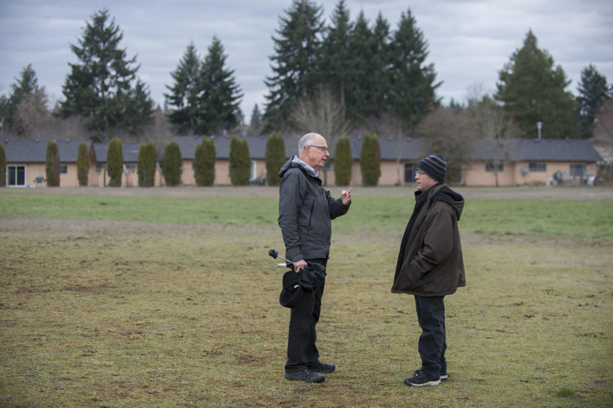 Bill Ritchie, chairman of the Clark County Commission on Aging, left, chats Thursday with Adam Kravitz, future site manager of the village for the homeless that will be built in a field at Safe Harbor Church of the Nazarene in Vancouver.