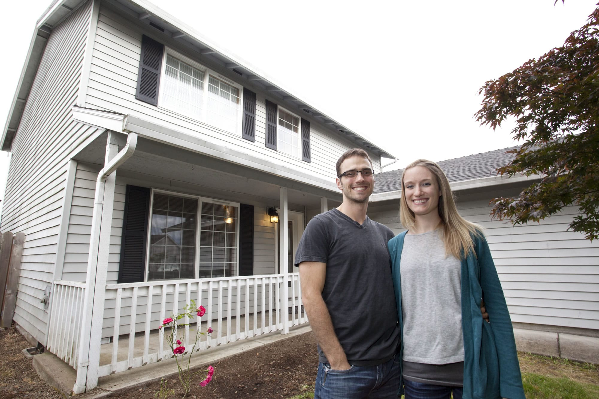 Hans and Amy Vierck had to install flooring in the home they wanted to buy on a short sale before their bank would approve a loan.