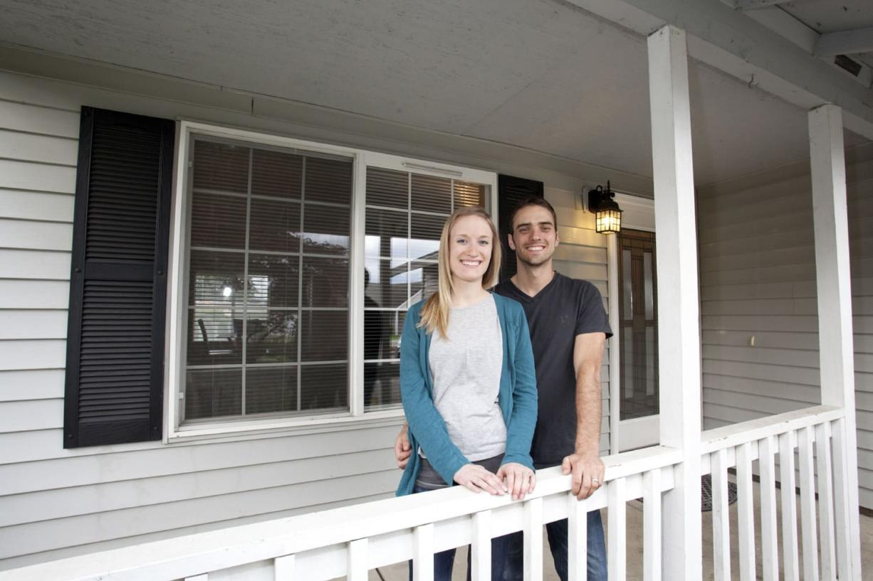 Amy and Hans Vierck had to install flooring in the house they wanted to buy on a short sale before their bank would approve a loan.