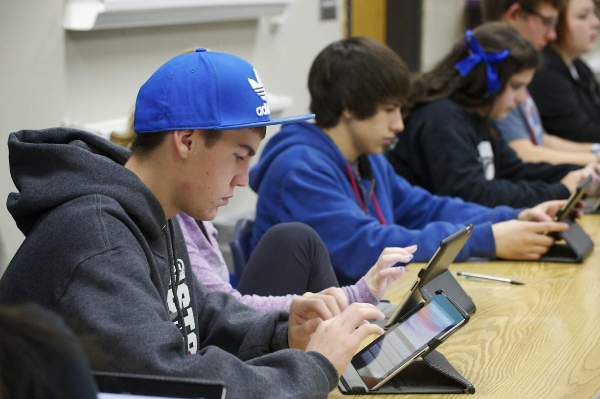 La Center High School student Alex Firl, 15, takes an assessment exam in Spanish class using an iPad Friday.