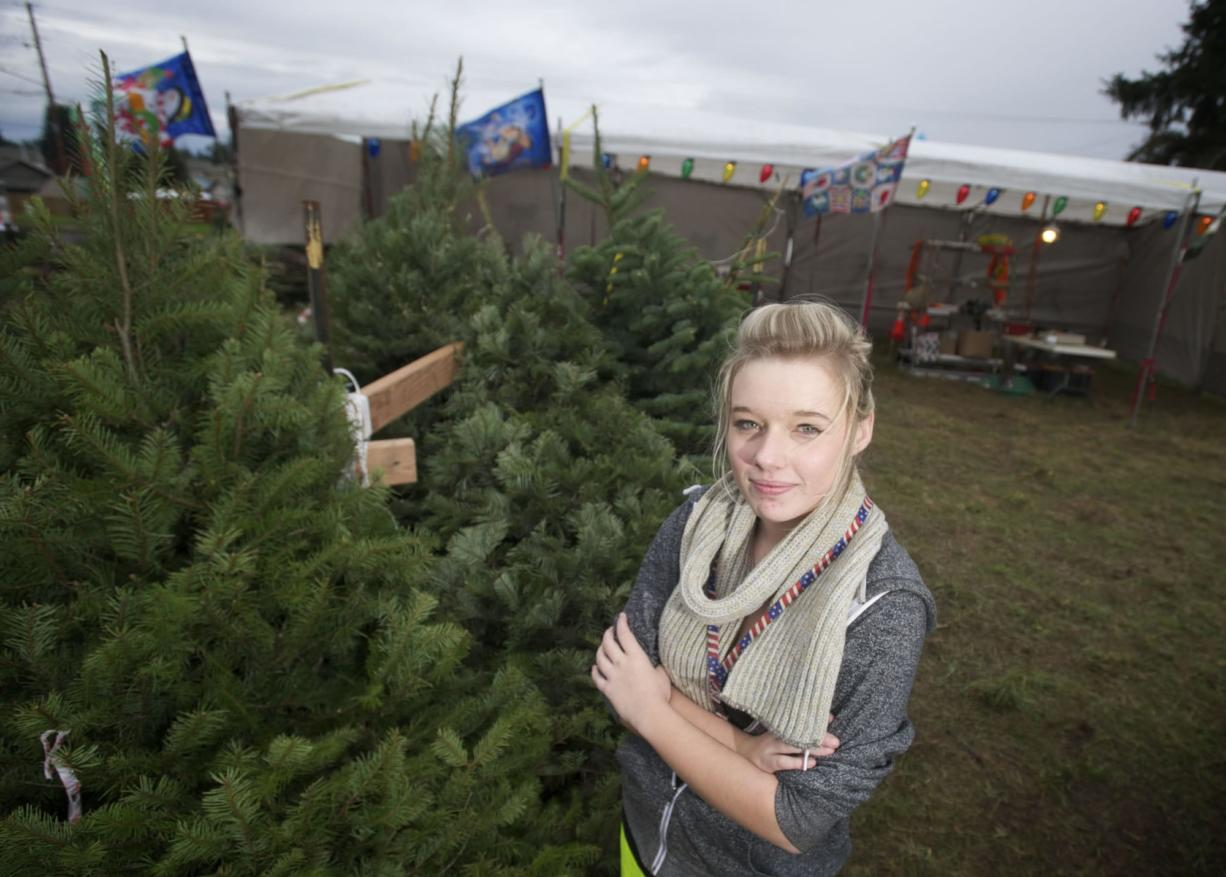 Kaitlyn Metscher, 16, operates a Christmas tree lot to help her save money for college.