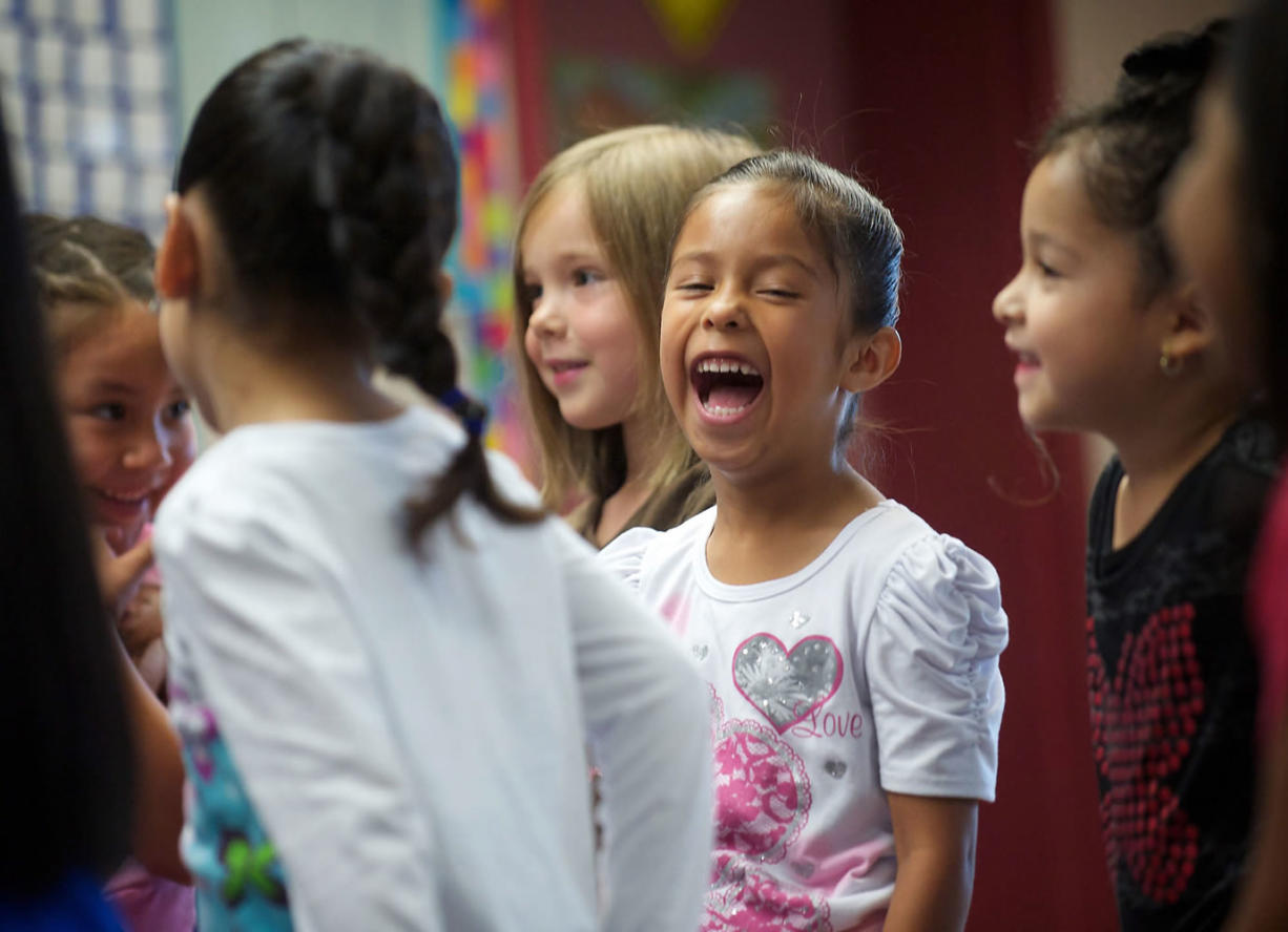 Kindergartner Ashly Prado Virelas, center, is one of about 500 students in Vancouver who went to school a few weeks early under the Jump Start program last summer.