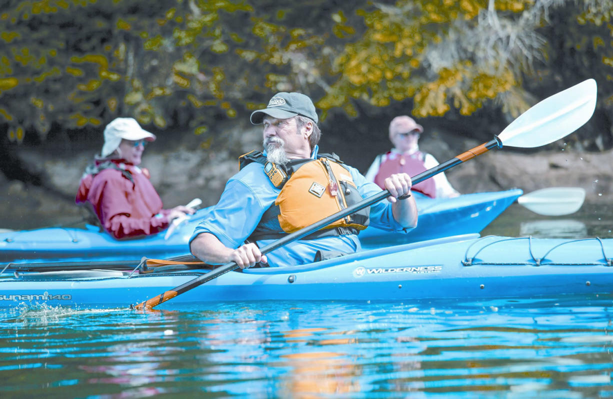 Bob Appling keeps track of members of the group as they paddle out of Cresap Bay on Lake Merwin.