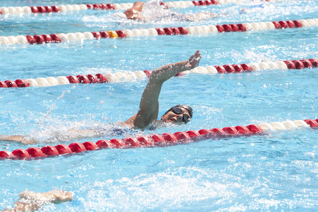 Arlene Delmage practices with her swim team, the Oregon Reign Masters, at Mt. Hood Community College in Gresham, Ore. The championship meet, from which the Vancouver woman brought home a cluster of medals, took place 10 weeks after she had a mastectomy.