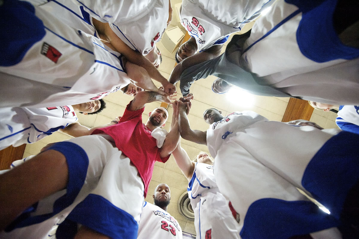 The Vancouver Volcanoes huddle after being introduced before their home opener on Sunday against the Bellingham Slam.