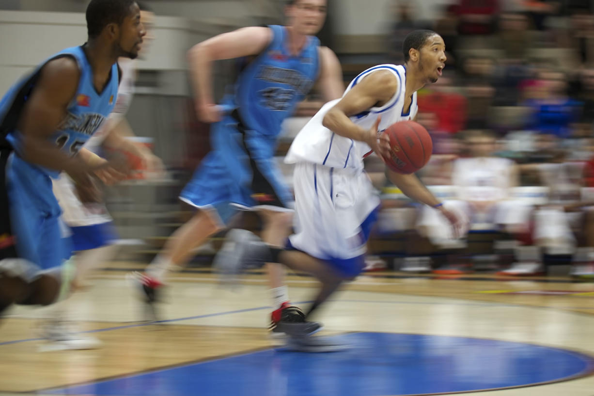 Vancouver Volcanoes' Josh Tarver drives up the court against the Bellingham Slam during the Volcanoes home opening game on Sunday at Clark College.