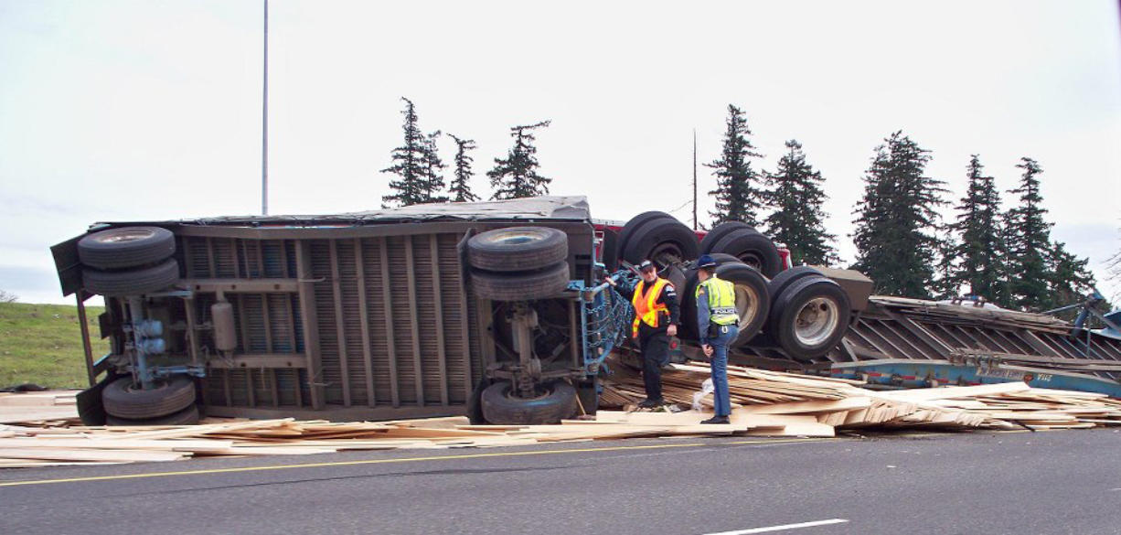 A lumber truck overturned on the ramp from state Highway 14 to Interstate 205 southbound Friday afternoon causing traffic in the area to backup.