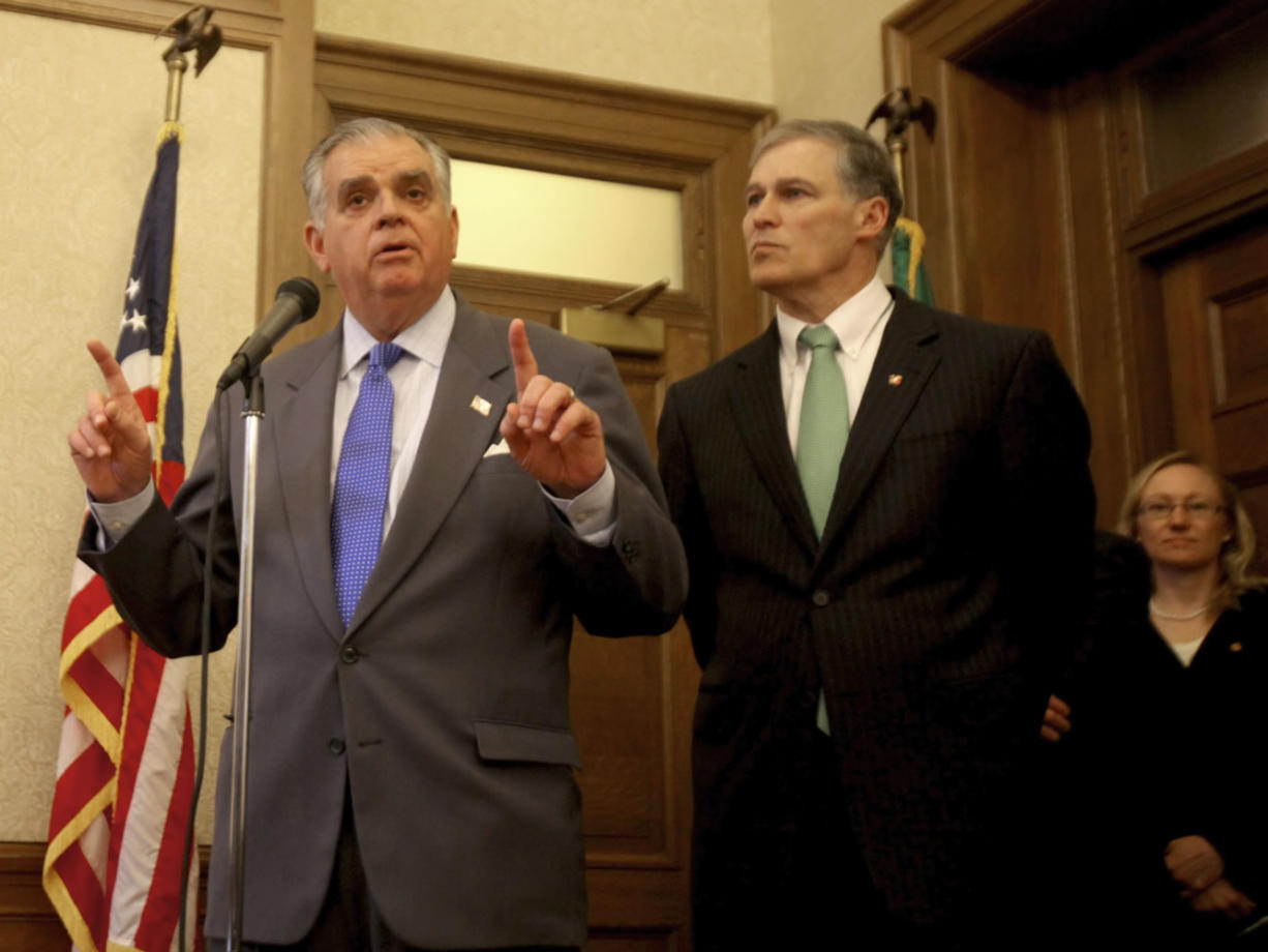 U.S. Transportation Secretary Ray LaHood, right, emphasizes the need for funding commitment for the Columbia River Crossing by the Washington state Legislature during a visit to Olympia on Wednesday. At left is Washington Gov.