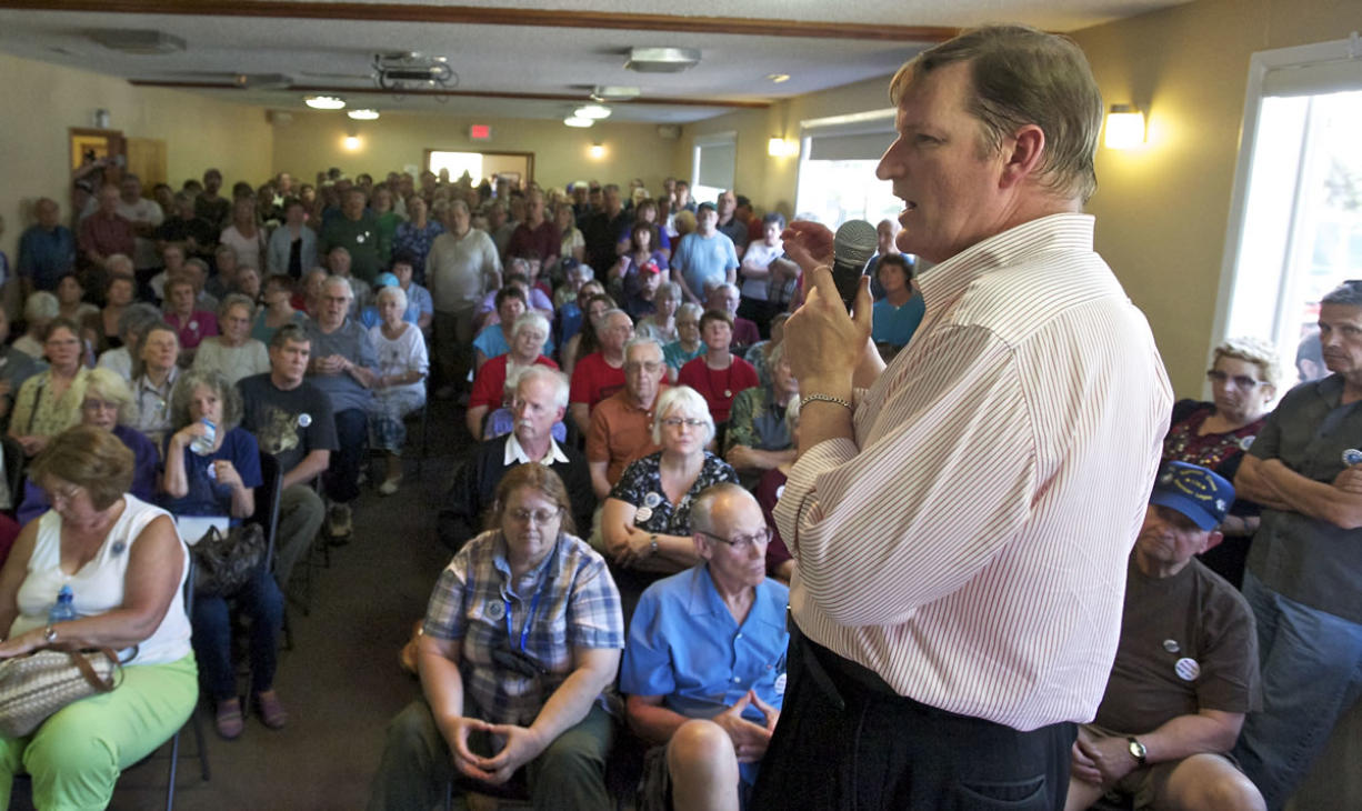 Former state Sen. Craig Pridemore talks to a packed house at the International Association of Fire Fighters Union Hall Saturday during an information-sharing event on options to voice displeasure with recent moves made by the Clark County Commissioners.