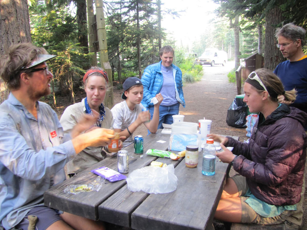 The hikers stop to refuel at Frog Lake near Mount Hood. PCT hikers can consume 4,000 or more calories per day.