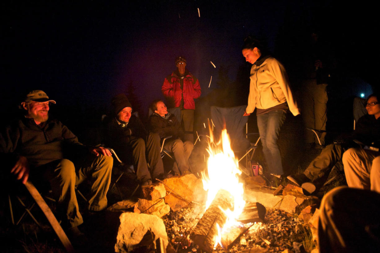 Sitting around a campfire, geologists from several countries swap tales about mysterious creatures at the Mount St. Helens Institute this month.